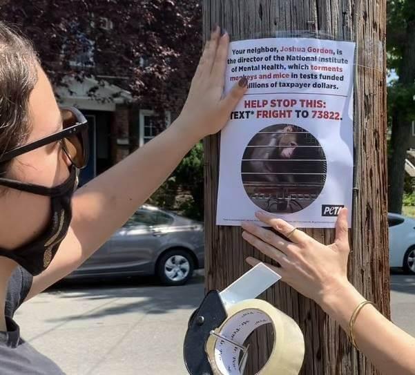 Activists posting a flyer
